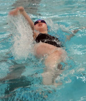 Andover High School swimmer Jill Dean competes in the backstroke leg of the 200-yard medley relay. The Trojans won the relay.