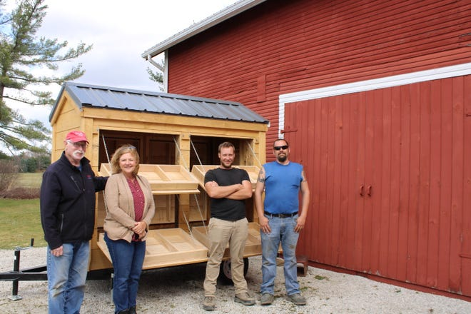 Pictured with the new produce cart for Case-Barlow Farm are, from left,  Jack Belby, Case-Barlow Farm trustee; Julie Lindner, Case-Barlow trustee,; Marcus Erb, Sugarcreek Builders,; and Michael Fueher, Sugarcreek Builders.