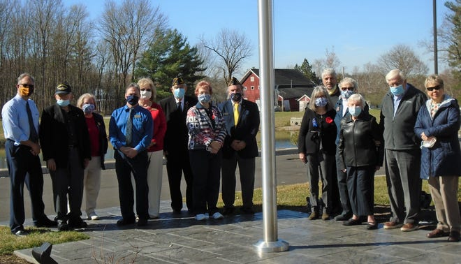 Hudson Meadows Retirement Community recently hosted a flag dedication ceremony at the newly opened senior living community.