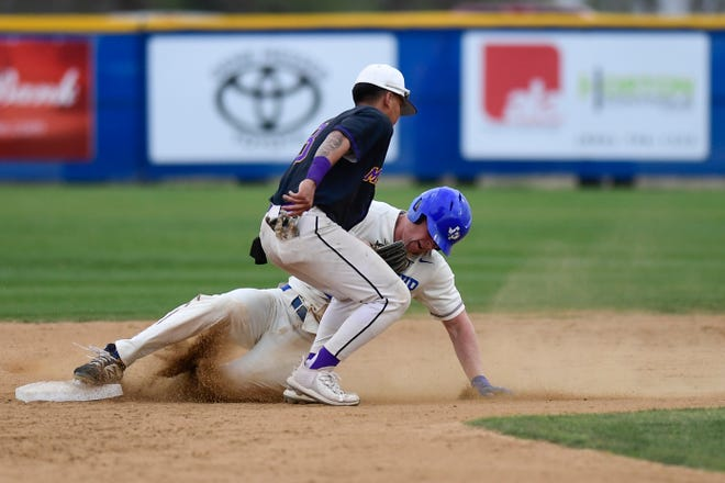 Frenship's Evan Johnson (14) slides safe into second base during a District 2-6A baseball game against Midland on Tuesday at Tigers Field in Wolfforth.