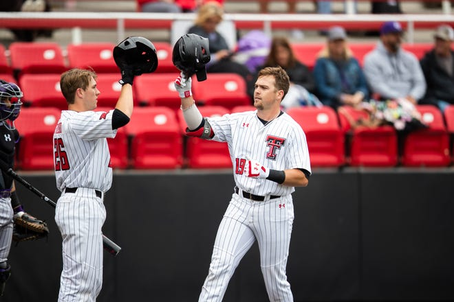Texas Tech's Easton Murrell (19) celebrates with teammate Braxton Fulford (26) after hitting a solo home run in the first inning of a nonconference game Wednesday, April 14, 2021 against Stephen F. Austin at Dan Law Field at Rip Griffin Park.