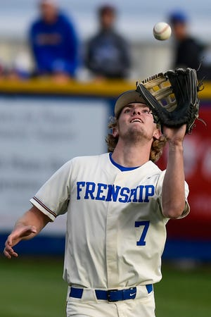 Frenship's Jake Sherrard (7) catches a fly ball during a District 2-6A baseball game against Midland on Tuesday at Tigers Field in Wolfforth. [Justin Rex/For A-J Media]