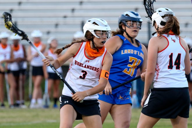 Lake Wales senior Brooke Dykes looks for an opening against Land O'Lakes during the semifinals of the Class 1A, District 5 girls lacrosse tournament at Legion Field.