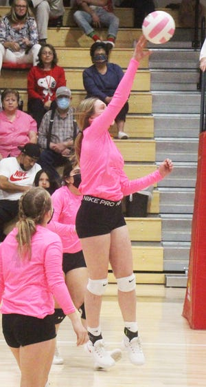 Rocky Ford High School's Gracie Moreland hits the ball over the net in Tuesday's match against Holly at the Melon Dome. Moreland had 12 kills and five service aces in the Meloneers' three-set win.