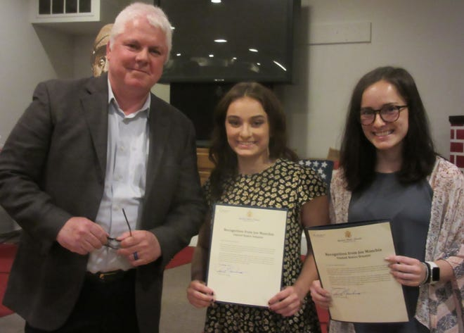 Tom Golden of the Aubrey Stewart Project presented (l-r) Carlie and Claire DelSignore with letters of commendation from Senator Joe Manchin for their efforts in the community.