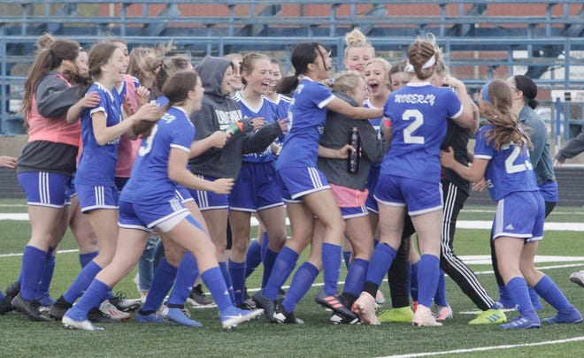 Moberly varsity girls soccer team congratulate one another Tuesday as they celebrate a grueling 1-0 home triumph against Fulton. The North Central Missouri Conference encounter went scoreless by the end of regulation, and required two overtime periods, and two shootout sessions with the second one being sudden death round.