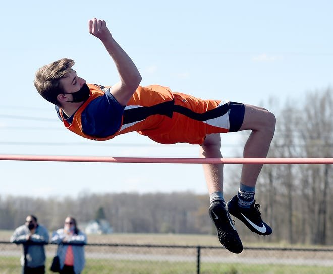 Drew Dafoe of Summerfield clears the bar in the high jump. Summerfield has qualified for the MITCA state team finals.