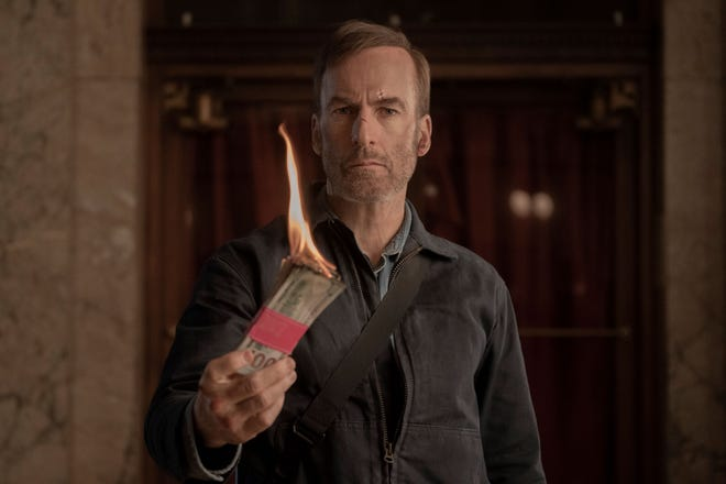 """Hutch (Bob Odenkirk) lets the bad guys know what he thinks of their dirty money in """"Nobody."""""""