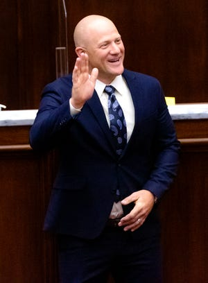 Sen. Jake Merrick, R-Yukon, waves to the gallery in the Oklahoma Senate chamber after being sworn into office at the Oklahoma state Capitol in Oklahoma City, Okla on Wednesday, April 14, 2021.