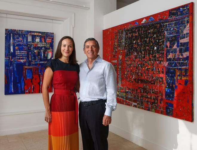 """Carla Berenice Groh and Joseph Knapek inside their newly opened gallery, Evey Fine Art, at 240 S. County Road. Pictured behind them are works by Cuban artist Esteban Leyva. At left is an untitled work from 2018; at right is """"Provocación,"""" from 2017. DAMON HIGGINS / PALM BEACH DAILY NEWS"""