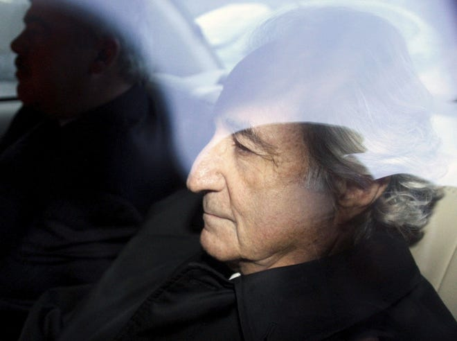 Bernard Madoff leaves U.S. District Court in Manhattan after a bail hearing in New York in January 2009. Mr. Madoff, the financier who pleaded guilty to orchestrating the largest Ponzi scheme in history, died early Wednesday in a federal prison. Kathy Willens, AP, File