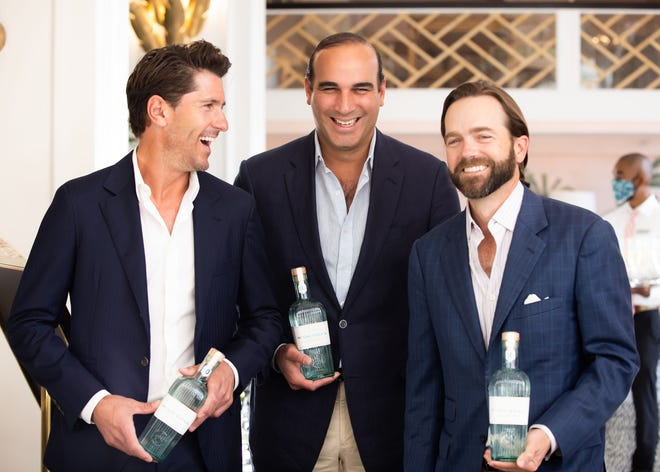 Nic Roldan, Diego Urrutia and Matti Christian Anttila, founders of High Goal Luxury Gin, hold bottles of the newly launched spirit.