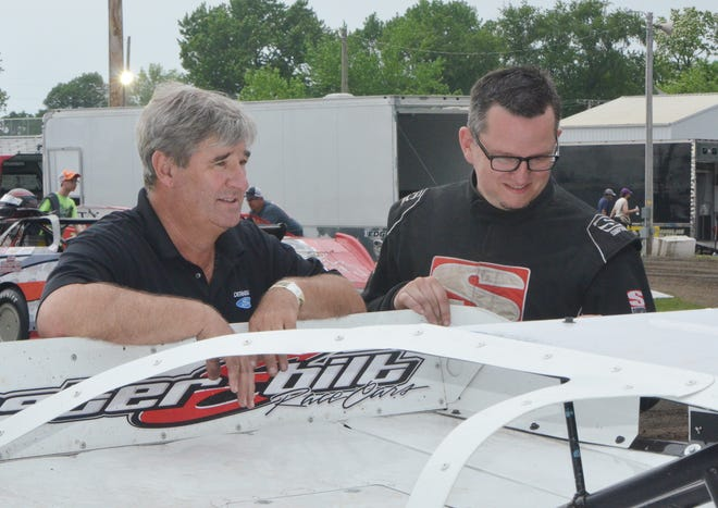 Randy Courtney (left), talks with Donny Walden before a race. Courtney passed away suddenly on April 11 at his home.