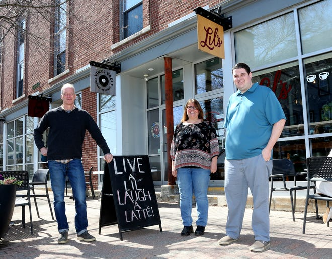 Michael Landgarten, left, is selling Lil's Cafe to Deb McCluskey and her son, Michael McCluskey.