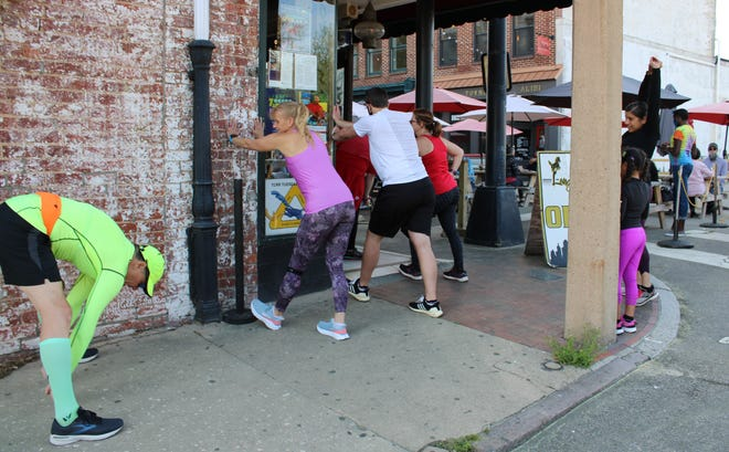 Runners from left to right, John Howe of Colonial Heights, Tri-Cities Road Runner President Brenda Beck of Prince George, Tim Vass of Dinwiddie, Deana Cheek of Dinwiddie, and the mother/daughter duo of Fort Lee with the same first name Anabel meet at Longstreet's Deli in Old Towne Petersburg for a group fun run on April 13, 2021.