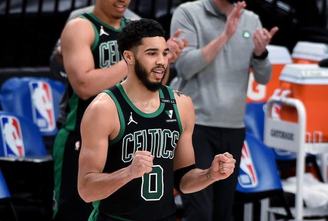Boston Celtics forward Jayson Tatum rects as the buzzer sounds and the Celtics defeat the Portland Trail Blazers in an NBA basketball game in Portland, Ore., Tuesday, April 13, 2021. The Celtics won 116-115. (AP Photo/Steve Dykes)