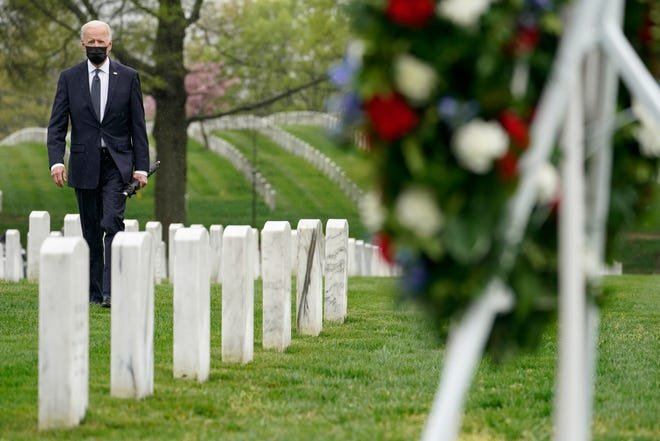 President Joe Biden visits Arlington National Cemetery in Arlington, Va., on Wednesday, the day he announced the withdrawal of the remainder of U.S. troops from Afghanistan by Sept. 11.