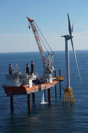 Crews finish the construction of the five towers of the Block Island Wind Farm in 2016.