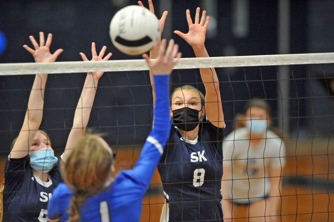 The Rebels' Carly Tomlinson keeps her eyes on Cumberland's Jennifer Carlmark as Tomlinson tries to get a block Wednesday at South Kingstown High.