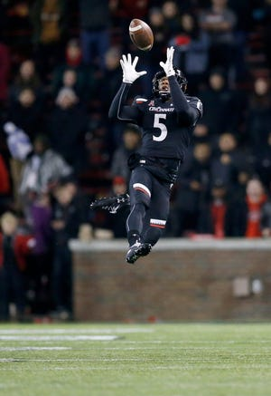 Cincinnati safety Darrick Forrest leaps to intercept a pass and seal the game for the Bearcats in the fourth quarter of the contest against Temple in November 2019 at Nippert Stadium in Cincinnati. The Bearcats clinched the American Athletic Conference East title with a 15-13 win.