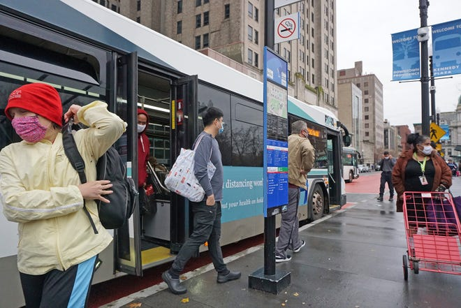 Bus riders get off at the Kennedy Plaza bus hub where many make their connections before they get to their destinations. [The Providence Journal / Sandor Bodo]