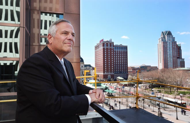 Former Providence Mayor and real-estate investor Joseph Paolino Jr. looks out over the city from his building at 100 Westminster St.