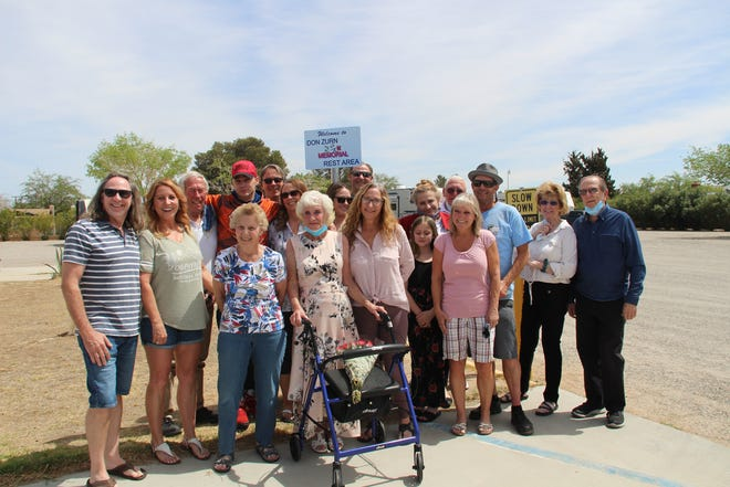 Members of the Zurn family pose with the new sign identifying 'Don Zurn Memorial Rest Area' after the ceremonial dedication on Saturday.