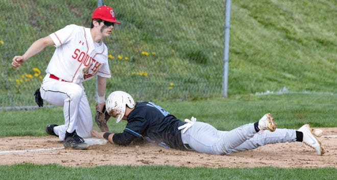 Alliance's Ryan Bruni slides safely into third base in front of Canton South's AJ Pierson on Tuesday, April 13, 2021.