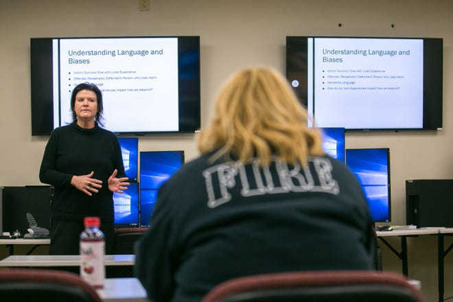Jennifer Cacciapaglia, manager of the Mayor's Office of Domestic Violence and Human Trafficking Prevention, trains a new class of 911 emergency dispatchers about domestic violence and spotting signs of strangulation on Wednesday at the Rockford Fire Department.