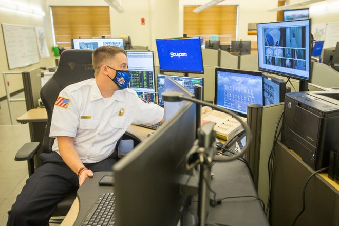 John Girone, a 911 shift supervisor, oversees all dispatchers' responses to calls to the city's 911 center to make sure the calls connect with the correct responders at the Rockford Fire Department on Wednesday, April 14, 2021, in Rockford.