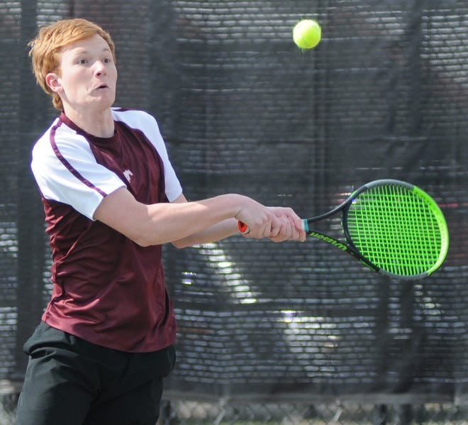 Salina Central's Max Shaffer hits a backhand during the semifinals of the Mustang Classic on Tuesday at the Central tennis courts. Shaffer and Reed McHenry went on to win the doubles title.