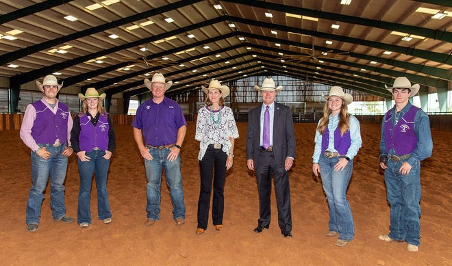 """A gift from Debbie Dorris and Ken """"Bubba"""" Dorris Jr. (center) has established the Dr. Ken and Virginia Dorris Memorial Scholarship to benefit student-athletes competing for the Tarleton State University Rodeo Team and those pursuing pre-veterinary degrees. Pictured (l-r) are current rodeo team members Jacob Perkey and Josie Fladager, head coach Mark Eakin, Debbie Dorris, Ken Dorris Jr., and team members Haley Polk and Trevor Lattin."""