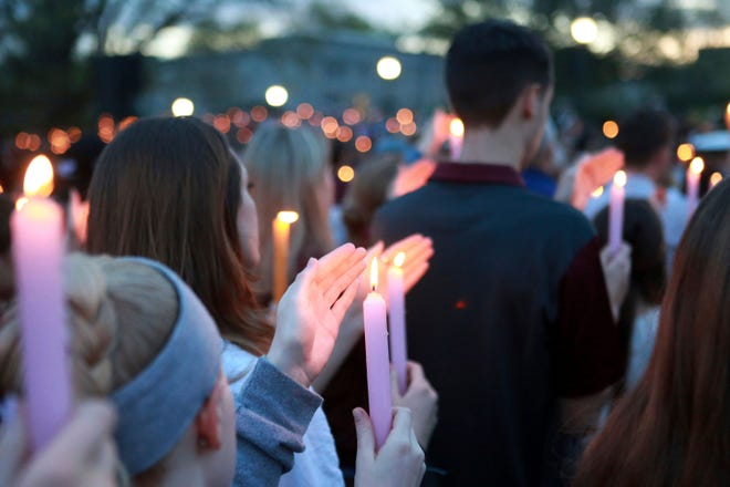 A crowd participates in a candlelight vigil in Blacksburg, Virginia, on April 16, 2017, marking the 10th anniversary of the mass shooting at Virginia Polytechnic Institute and State University, known as Virginia Tech.