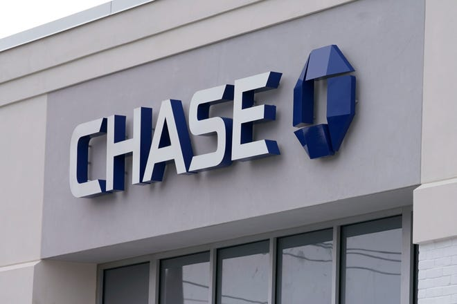 JPMorgan Chase, the nation's largest bank by assets, said on Wednesday it earned $14.3 billion, or $4.50 per share, in the year's first three months.