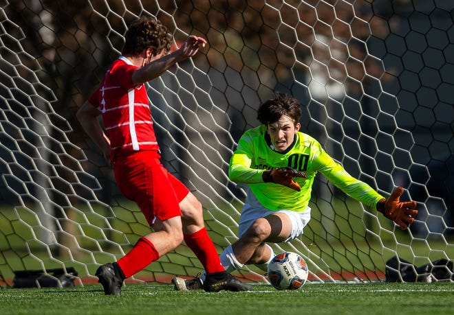Glenwood's Tyler Marconi (4) sends a goal in past Rochester goal keeper Adam Anderson (00) in the first half during the CS8 Tournament at Glenwood High School in Chatham, Ill., Tuesday, April 13, 2021. [Justin L. Fowler/The State Journal-Register]