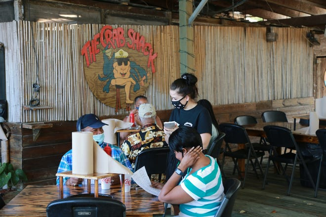 A waitress greets customers at The Crab Shack on Tybee Island.
