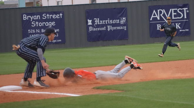 Shawnee third baseman Easton Odell applies the tag on the Coweta baserunner off a throw from catcher Creed Muirhead Tuesday night. In the background is Shawnee left fielder Cade Chamblin.