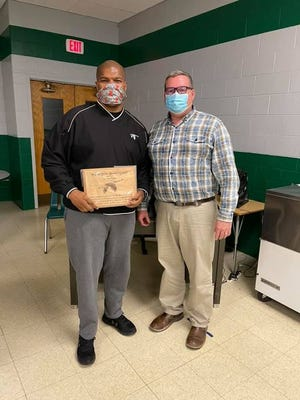 Wethersfield School Board president Dan Bryan, right, presented a plaque to Tyrone Baker during the board's April 8 meeting in appreciation of the 10 years he served on the school board. Baker resigned his school board seat after being elected to the Kewanee City Council on April 6.