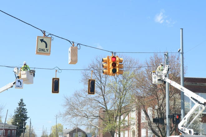 Workers from J. Ranck Electrical install new traffic lights and cameras Tuesday at the intersection of Nottawa and West streets.