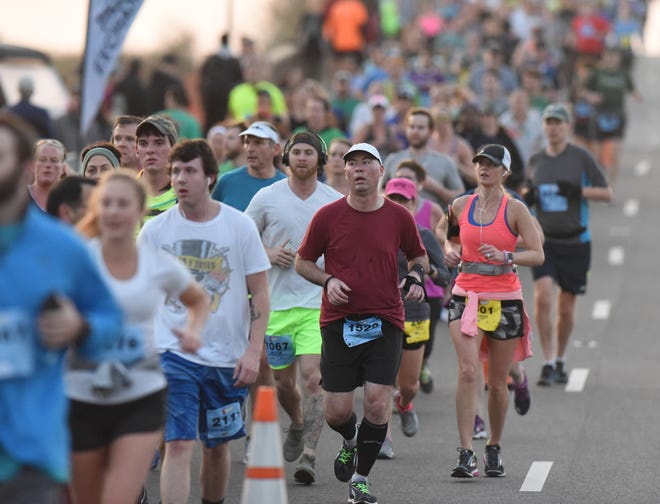 Runners will have to go off in smaller waves in 2021, but more than 1,200 runners are still expected for Saturday's Wilmington Marathon races through downtown and Greenfield Lake.