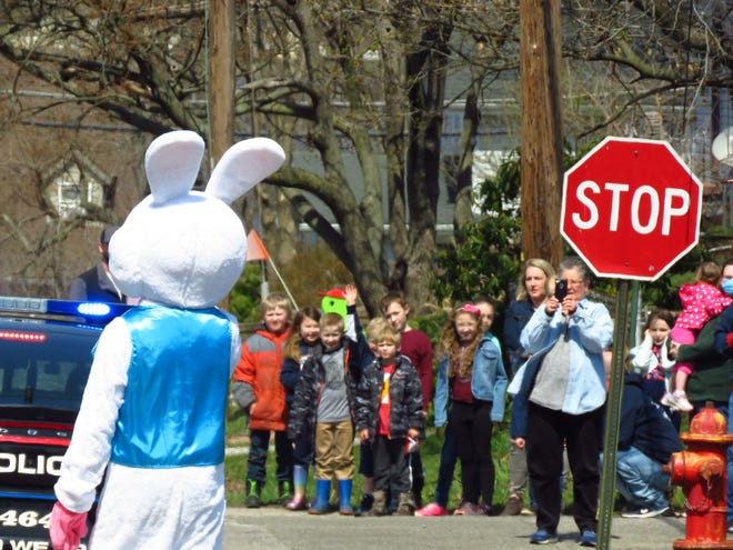 A crowd in Lakemore gathers as the Easter bunny made his way through the village.