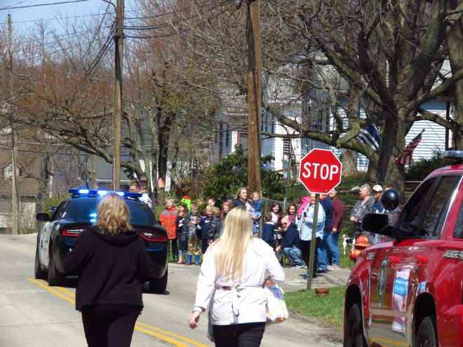 A crowd gathers as the Easter Bunny made his way through Lakemore in this file photo. The village is celebrating its 100th birthday on Sept. 4 and Sept. 5, 2021