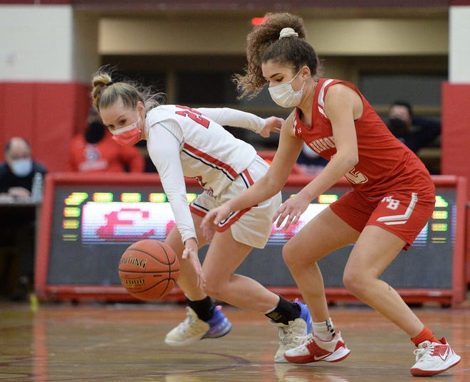 Bridgewater-Raynham's Kenzie Matulonis, left, steals the ball from a New Bedford player in the SEC finals at Bridgewater-Raynham Regional High School.