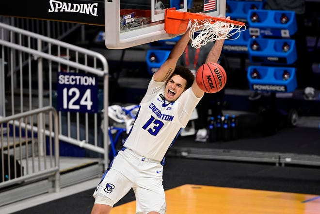Creighton Bluejays forward Christian Bishop (13) dunks against the Ohio Bobcats in the second half in the second round of the 2021 NCAA Tournament at Hinkle Fieldhouse on March 22, 2021.
