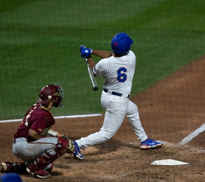 Florida's Kendrick Calilao drills a walk-off home run in the bottom of the 10th inning Tuesday to give the Gators a 3-2 win over Florida State at Florida Ballpark.