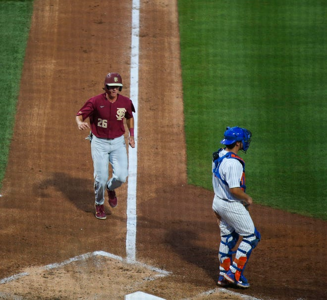 The Seminole's Robby Martin (26) puts the Seminoles on the board against the Gators, Tuesday, April 13, 2021, at Florida Ballpark in Gainesville, Florida.  [Cyndi Chambers/Special to the Sun] 2021