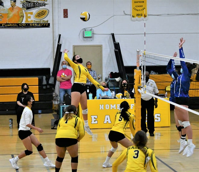 Pueblo East sophomore Grace Helzer skies up for a slam in the Eagles' 3-2 win over visiting Pueblo Central Tuesday, April 13, 2021 at Melvin L. Spence Gymnasium.