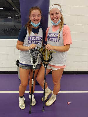 Central girls lacrosse players Brenna Todd (left) and Riley Smith both have turbulent histories when it comes to injuries but are standing out this season for the Tigers. Smith is a senior attacker and Otterbein recruit. Todd is a junior midfielder who also can play attacker and defender.