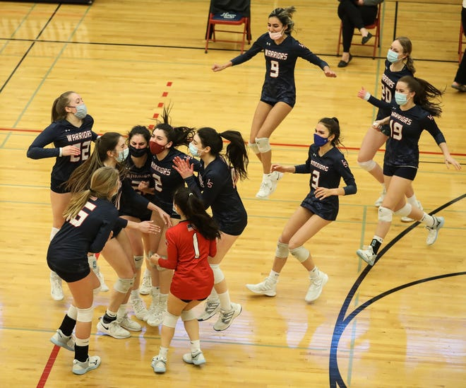 The Lincoln-Sudbury High School girls volleyball team celebrates after defeating Acton-Boxborough in the fourth set of a Dual County League semifinal championship game, April 13, 2021.