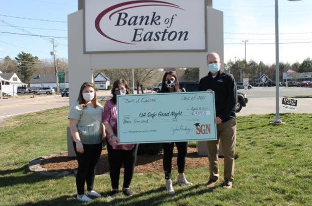 Bank of Easton recently donated $3,000 to Oliver Ames High School for their Safe Grad Night Parade. Pictured are OA Safe Grad members Allie Goveia, Debbie Goveia, Stephanie Blass and Bank of Easton President John Morley.